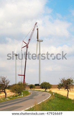 Wind turbines construction with the help of a crane - stock photo