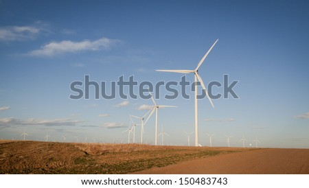 Wind turbines farm at sunset in Limon, Colorado. - stock photo
