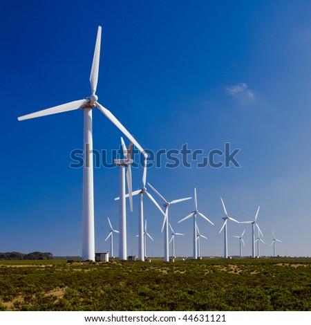 Wind turbines farm generating clean energy  trough the window - stock photo