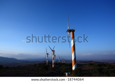 Wind Turbines Fram under blue skies - stock photo