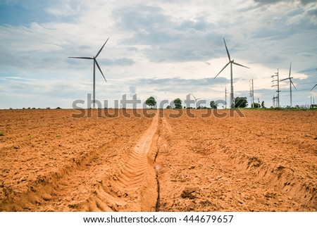 Wind turbines generate electricity at field all agriculture plantation in thailand - stock photo