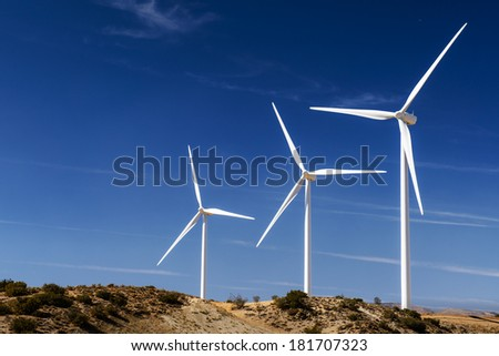 Wind turbines generating electricity in Americas desert - stock photo