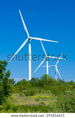 Wind turbines generating electricity. Nature protection concept - stock photo