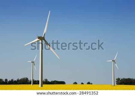 Wind turbines in a field - stock photo