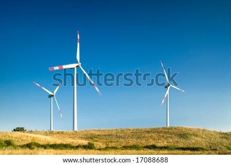 wind turbines in a wind farm - stock photo