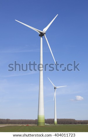 wind turbines in the dutch province of flevoland with blue sky in sunny weather. - stock photo