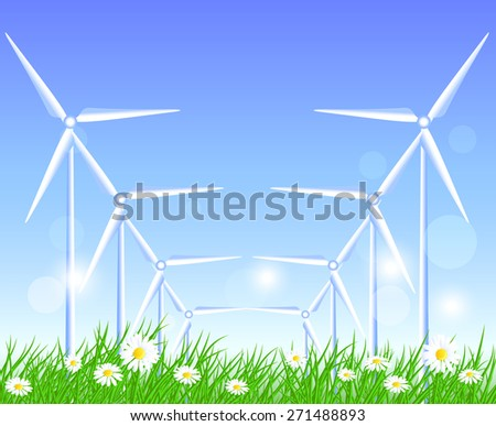 Wind turbines in the field with flowers - stock photo