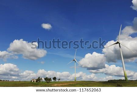 wind turbines in the fields under blue sky - stock photo