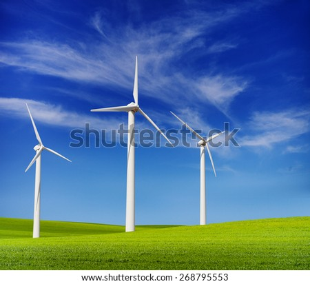 wind turbines in the green hills - stock photo