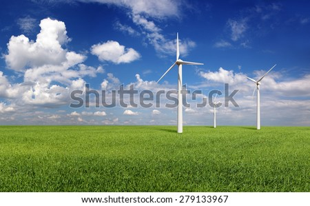 wind turbines in the green hills. Green energy concept - stock photo