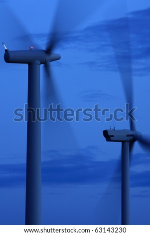 Wind turbines in the late evening light - stock photo