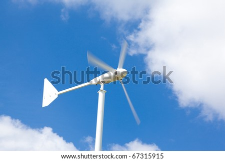 Wind Turbines in the with blue cloudy sky - stock photo