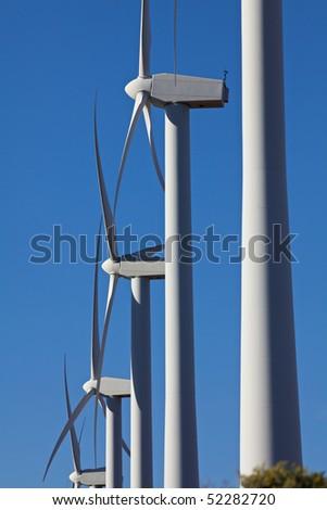 Wind Turbines on Alternative Energy Windmill Farm - stock photo