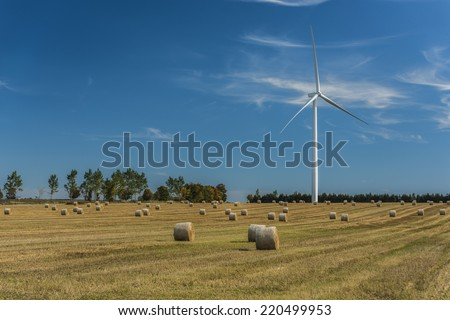 Wind turbines, on farmland, situated in Mansfield Ontario Canada, lots of copy space - stock photo