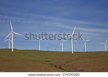Wind turbines on hillside near Columbia River in Washington - stock photo