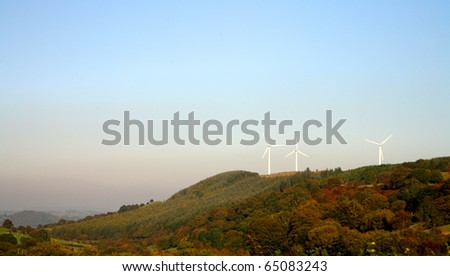 wind turbines on mountain in wales, united kingdom - stock photo