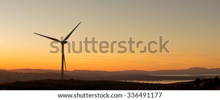 Wind-turbines on the Croatian coast ,  wind turbines at sunset - stock photo