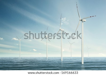 Wind turbines on the ocean - stock photo