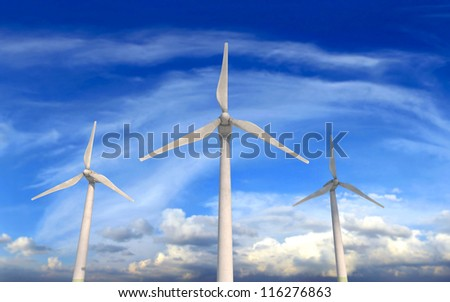 Wind turbines on windy and cloudy day - stock photo