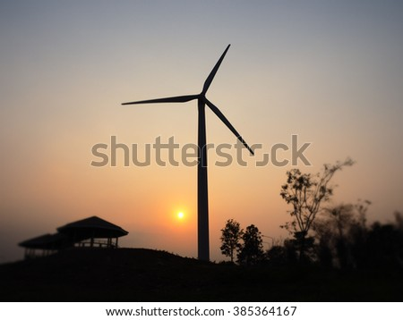 wind turbines power generator at sunset background - stock photo