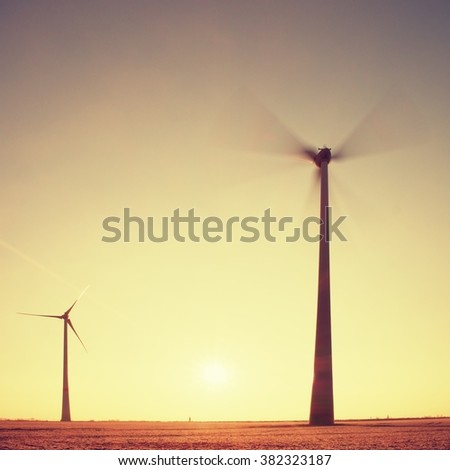 Wind Turbines Producing Electric Energy within  sunny spring morning. Vintage Style Toned effect - stock photo