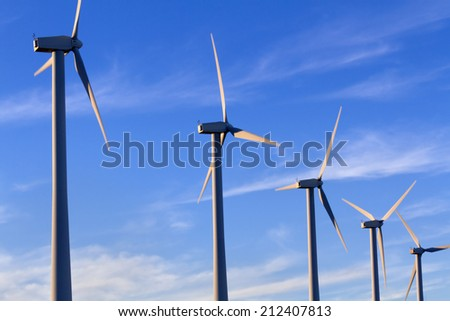 Wind Turbines with blue sky and clouds, Palm Springs, CA - stock photo