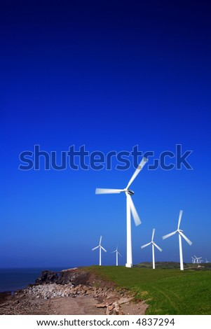 Wind turbines with copy space. - stock photo