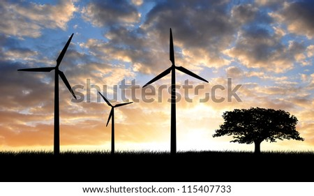 Wind turbines with tree in the sunset - stock photo