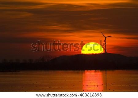 wind wheel at sunset, bavaria, germany - stock photo