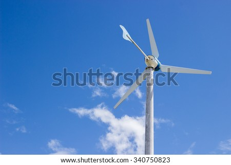 Wind wheel electric and blue sky - stock photo