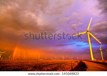 Windfarm at the sunset - stock photo