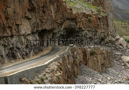 Winding and dangerous road from Gilgit to Chitral in Karakorum mountains in Pakistan - stock photo
