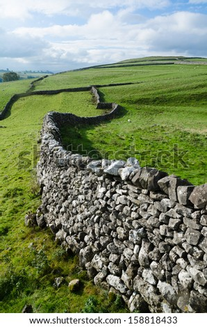 Winding drystone wall across the dales. UK - stock photo