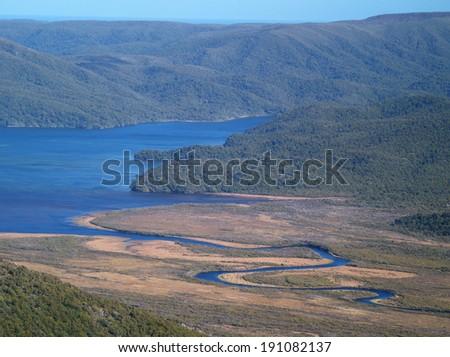 Winding Freshwater river, Stewart island, New Zealand - stock photo