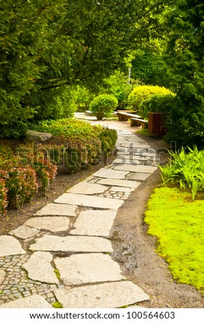Winding garden alley - stock photo