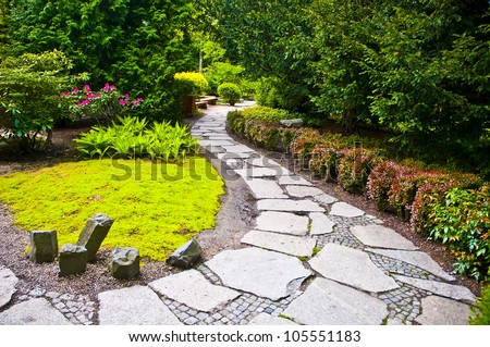Winding garden alley - stock photo