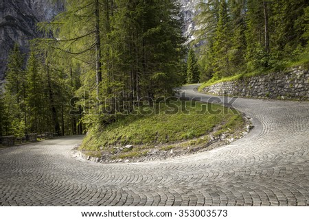 Winding mountain pavement road - stock photo