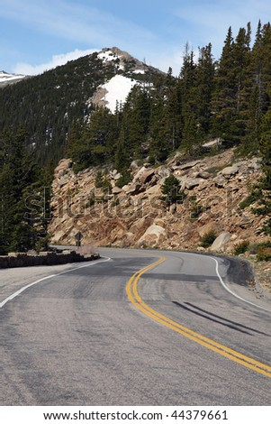 winding mountain road, vertical - stock photo