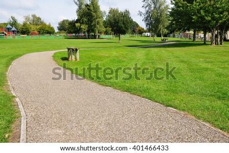 Winding Path through a Beautiful Green Park  - stock photo