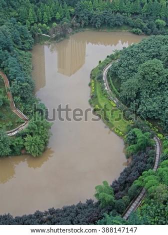 winding river in the city Chongqing, China - stock photo