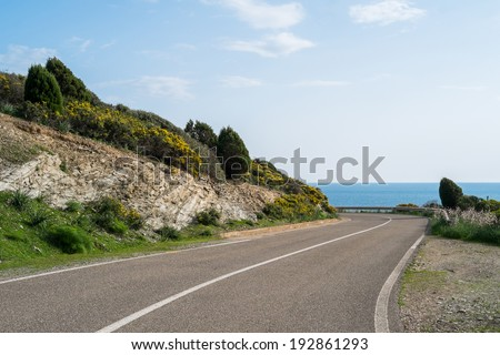 Winding road along the coast in Teulada, Sardinia, Italy - stock photo
