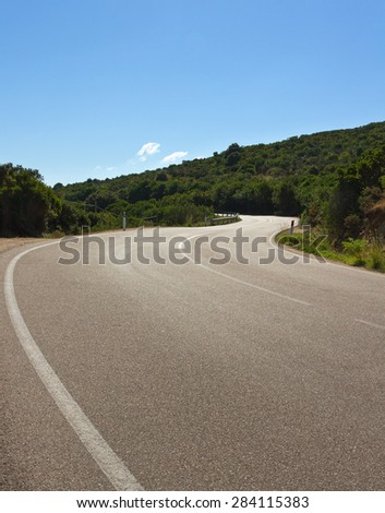 Winding road at the Palau district. - stock photo