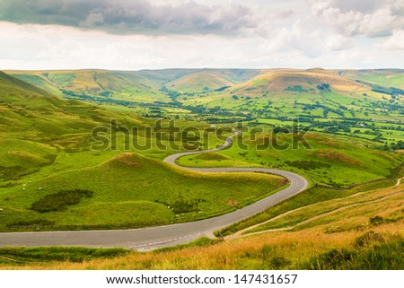 Winding Road from Mam Tor, Peak District, Derbyshire, England, UK - stock photo