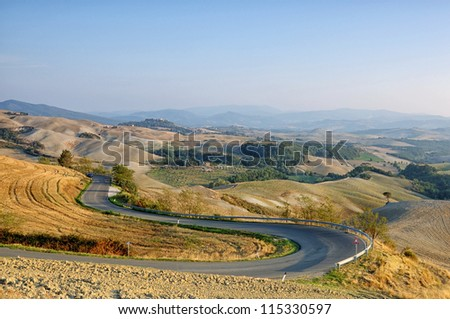 Winding road in autumn Tuscany, Italy - stock photo