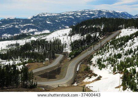 Winding road in mountain washington, vancouver island, british columbia, canada - stock photo