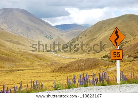 Winding road in the mountains, New Zealand - stock photo