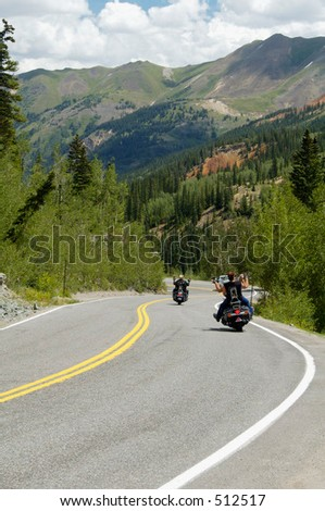 Winding road through the Rocky Mountains. - stock photo