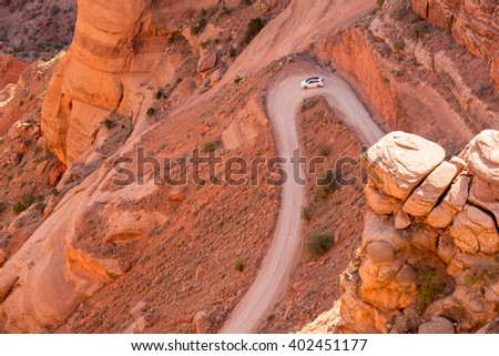Winding rough rocky dirt unpaved road metaphor for challenge trial struggle - stock photo