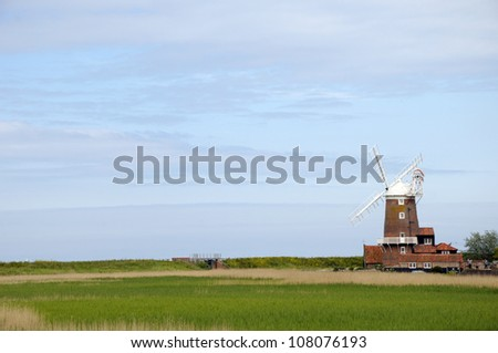 Windmill across marshes at Cley, Norfolk - stock photo
