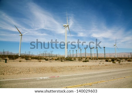 "Windmill AKA ""Wind Turbine"" or ""Wind Farm"" with windmills in the desert of Palm Springs in Southern California - stock photo"